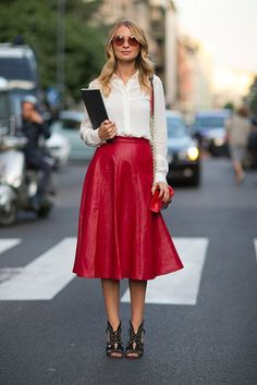 Red vegan leather long flare skirt worn with a white button up, round sunglasses, and red leather purse with gold detailing.. Get the supplies to make it: http://mjtrends.com/pins.php?name=red-vegan-leather-fabric-material