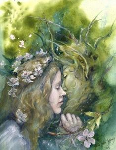 After the long hard winter, at last, The May Queen and The Green Man come together for a kiss amid the bright blossom!   This is a small print (5
