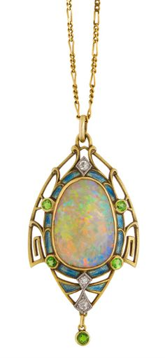 Art nouveau opal pendant framed in gold set with diamonds, enamel and demantoid garnets