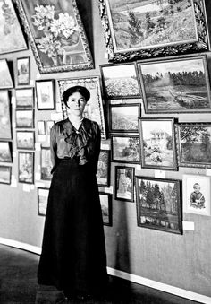 Grand Duchess Olga Alexandrovna Romanov, daughter of Alexander III, sister of Nicholas II, on the background of her work at a charitable exhibition in her own palace. Photographer: I. N. Alexandrov. (1914).