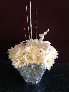Very untraditional arrangement, a gift to a friend. With keepsake figurines.