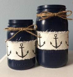 Painted a lovely navy blue, embellished with jute twine and anchor canvas ribbon. Set includes one pint size and a quart size Mason jars.