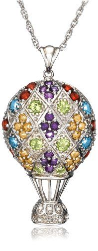 A rainbow of multi-color gemstones elevates this sterling silver hot air balloon pendant to a top level of elegance. This playful design is dressed with a total of 58 round gemstones, including purple amethyst, red garnet, blue topaz, light green peridot, and golden orange citrine. Also featured in the mix are petite round diamonds, decorating the balloon basket. The pendant dangles from a pretty sculpted bail and is suspended from an 18-inch ste...