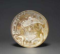 Luster Bowl with Antelope, Cleveland Museum of Art: Islamic Art The expensive and unpredictable luster technique was transmitted by Iraqi potters to the more prosperous Fatimid court in Cairo. Pottery Plates, Ceramic Pottery, Fatimid Caliphate, Ancient Persian, Cleveland Museum Of Art, 11th Century, Ceramic Decor, Ancient Artifacts, Tile Art