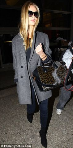 Grey day: The 26-year-old sported an ensemble in sober hues with her gold hair providing a...