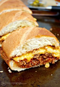 This Bacon Cheeseburger Stuffed French bread is packed with a flavorful beef mixture and then topped with a gooey layer of cheese! Add additional condiments for a full burger experience! The Foodie Affair Beef Recipes, Cooking Recipes, Bacon, Sandwiches, Good Food, Yummy Food, Tasty, Sandwich Recipes, Appetizers For Party