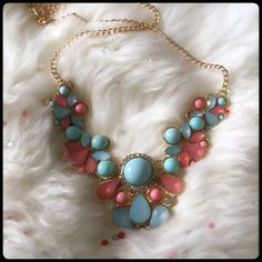 """Statement """"Drop"""" Necklace Exquisite statement necklace in a chunky style. The light pastels of turquoise & coral combined with crystals are perfect for showing the softer side of YOU. The design is lovely with upside down tear drops, circular patterns and rhinestones. Just the right amount of """"pop"""" to add to your wardrobe. The chain is adjustable with a complete length of approximately 24 inches. Jewelry Necklaces"""