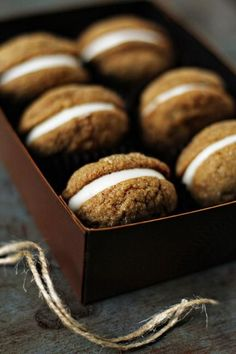 pumpkin molasses cookies with cream cheese filling.
