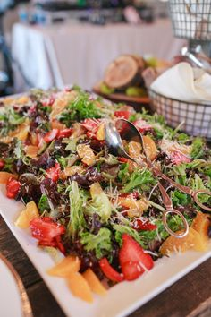 Strawberry orange baby greens salad, a perfect summertime salad. Ravishing Radish Catering | Amanda Lloyd Photography