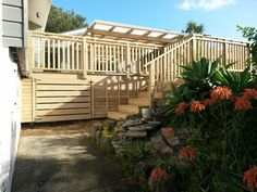 All pine construction, roofed deck area with seating gates, and surround handrails.
