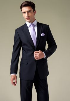 This navy 2 button wool suit, characterized by its masterful tailoring and design, is suitable for all occasions.