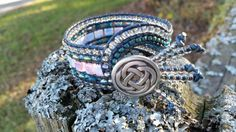 Check out this item in my Etsy shop https://www.etsy.com/listing/208523023/handmade-antiqued-blue-leather-wrap