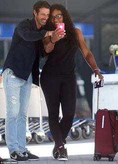 Say cheese! Serena Williams and Patrick Mouratoglou pose for selfies as they arrive at Perth International Airport ahead of the Hopman Cup