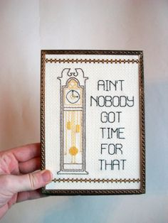 Aint Nobody Got Time for That Cross stitch -- internet meme, autotune song themed cross stitch with grandfather clock. $45.00, via Etsy.