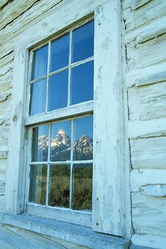 Image of the Tetons reflecting in an old cabin window in Grand Teton National Park near Jackson, Wyoming. Grand Teton National Park, National Parks, Window Reflection, Old Cabins, Teton Mountains, Jackson Wyoming, Maybe Someday, Old Houses, Abandoned