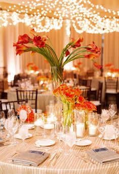 Romantic table setting with clear glass plates with gold ...