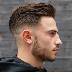 Mid Fade with Long Slicked Back Hair and Short Beard Style