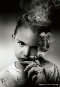How do you tell your child to stay away from cigarettes while you're puffing smoke into his face?