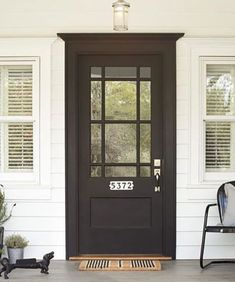 Make bright-white porcelain-tile house numbers, (about $75; /rejuvenationinc/), pop for mail carriers and visitors alike with a stark, sophisticated black-painted front door.