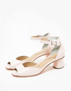 From Rachel Comey, a modern sandal in Blush. Featuring a leather upper, open toe, adjustable ankle strap with buckle closure, suede lined heel box, leather heel pad and leather sole with stacked leather heel. Comes with branded dust and travel bag.   •