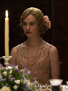 Lily James as Lady Rose McClare in Downton Abbey (TV Series, 2014).