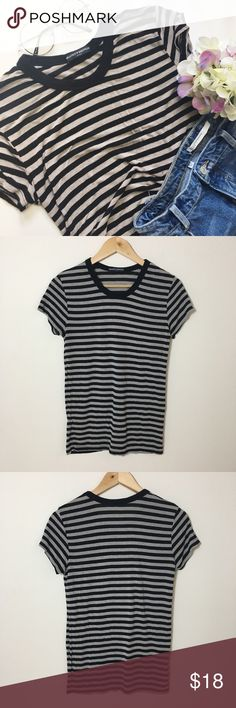 "Brandy Melville Black and Grey Striped Tee Size OS EUC Brandy Melville short sleeve tee in size OS. There is a stretch to this top. Super soft and comfy.   Measurements provided have been rounded up by quarters, halves, and whole inches. Chest: 32"" Length: 25"" Brandy Melville Tops Tees - Short Sleeve"