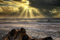 Sunset over the Tasman Ocean from Hokitika, South Island, New Zealand, in between the rain downpours