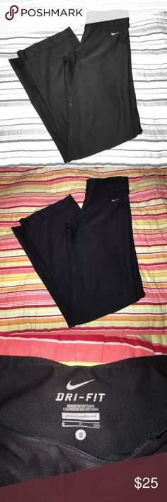 Nike Dri-Fit pants Size small Nike Dri-Fit long black pants with a boot cut leg. 88% polyester, 12% spandex. A little pilling on the outer seams, but nothing noticeable while worn. Nike Pants Track Pants & Joggers