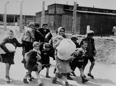 [Jewish+women+and+children+from+Subcarpathian+Rus+who+have+been+selected+for+death+at+Auschwitz-Birkenau,+walk+toward+the+gas+chambers.jpg]
