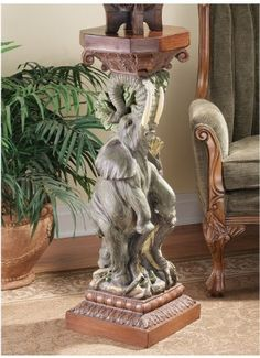 The Elephant's Triumph Sculptural Pedestal by Design Toscano. $175.00. Hand painted. Design Toscano exclusive. Cast in quality designer resin. JE121915 Features: -Cast in quality designer resin.-Hand painted. Color/Finish: -Full color realistic.