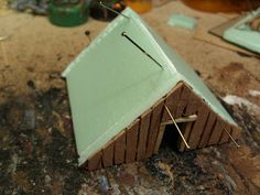 A little article on how I made the saxon houses   Tools needed...some green insulating foam, Matchsticks, some thin woodsheeting (an old dra...