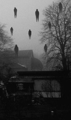 spooky atmospheric chilling surreal photographic art print , reminiscent of the art of magritte burt with a scarey feeling of bodies being taken away abduction against their will halloween art