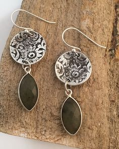 You can never go wrong with silver earrings with a classic feel