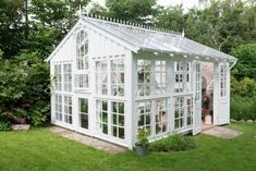 Here we see an ornate and decorative take on the greenhouse. There is no need for a greenhouse to fit into a mold. This greenhouse shows us that you can also add some personal touches to your utility buildings. Window Greenhouse, Greenhouse Effect, Backyard Greenhouse, Greenhouse Growing, Small Greenhouse, Greenhouse Plans, Greenhouse Wedding, Portable Greenhouse, Pallet Greenhouse