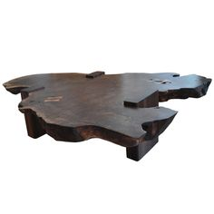 Walnut Slab Coffee Table by Richard Patterson  USA  Circa 21st century  For the past 30 years R. Patterson has been creating timeless pieces.Today he continues to search for the most elegant and refined design solutions through a process of subtraction, distilling the forms to the basic essence of wood. The coffee table is signed and dated.