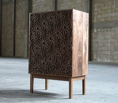 Sakura Sideboard by Laszlo Beckett featuring pixelated cherry blossoms inspired by the work of designer George Nakashima and jeweler Jo Hayes Ward.