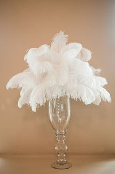 Bouquet of white feathers in a clear slender vase - photo by Portland wedding photographer Barbie Hull