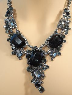 Fit for the Opera! Stunning ensemble of black crystals in a necklace reminiscent of the one Christine wore in her performance at Coney Island. Adjustable, fits snugly or at your desired length. Matching earrings, 1.5 inches long, are included. The Phantom would approve!
