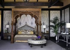 #Poster Bed with round #ottoman and carved wood #headboard by Martyn Lawrence Bullard