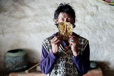 A man wears a funerary mask of gold and silver that is about 1,500 years old. It was found in a box inside a cave in Sam Dzong, a village that has been the last stop before the border with Tibet and China. 2014. (David Rengel) A fortress in the sky, the last forbidden kingdom of Tibetan culture - The Washington Post