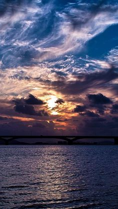 Download Dramatic Clouds Sunset Over Bridge iPhone 6 Wallpaper iphonewalls.net