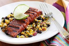 Smoky Spice-Rubbed Grilled Salmon w/ black beans and corn, only 399 calories/serving I skinnytaste Corn Recipes, Salmon Recipes, Fish Recipes, Seafood Recipes, Great Recipes, Healthy Recipes, Favorite Recipes, Ww Recipes, Recipies