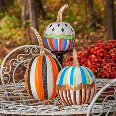 Painted geometric patterns and a gold stem create eye-catching pumpkins. See details and more pumpkin inspiration in our story! Painted Pumpkins, Faux Pumpkins, Outdoor Halloween, Halloween 2020, Artificial Pumpkins, Leaf Stencil, Black Construction Paper, Easy Fall Crafts, Black Acrylic Paint