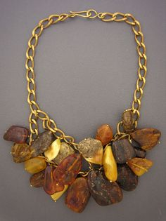 Necklace   Anna Holland ~Dorje Designs.   Wonderfully old and lightweight amber pieces, ranging from off-white to caramel  to a rich honey color, hanging from a brass chain.