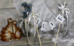 LOVE Wedding Cake Topper Banner with pearls and bows on Etsy, $18.00