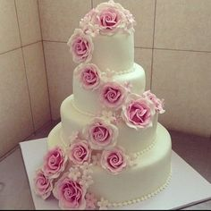 classy white wedding cake with cascading pink roses