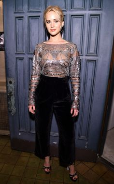 Bulletproof from Fashion Police  Jennifer Lawrence is wrapped up in silver studs in achainmail-inspired Naeem Khan blouse that she teams with a pair of high-waisted pants at the Dinner for Equality in Los Angeles. The actress completes the look with crystal-embellished Sophia Webster heels and minimal makeup and jewelry.
