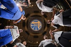 """nba: """"Team captains Stephen Curry and Andre Iguodala of the Golden State Warriors meet center court alongside captain Tim Duncan of the San Antonio Spurs and the officiating crew on November 11, 2014..."""