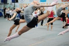 Floating through the air and making it look sooooo easy.....wow, this girl was born to dance!