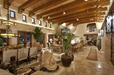 Magnificent 5-acre privately gated territorial masterpiece at the foothills of Mummy Mtn in Paradise Valley.